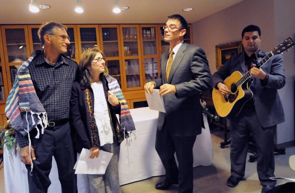 Hillel director Marc Bragin recites a blessing to Ark artists Jack Esslinger and Audrey Fenigstein, Ark dedication, December 23, 2007.
