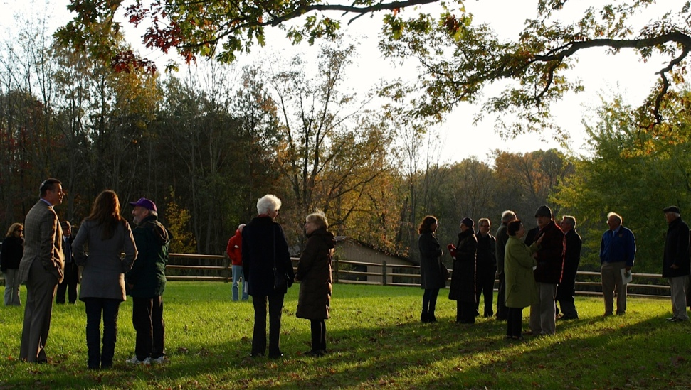 People gathering at the cemetery site following the consecration ceremony, October 24, 2013.